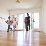 Excited Family Moving into New Home